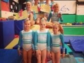 Artistic Gymnastics Squad with certificates