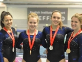 Gymnastics Tumbling Girls with Medals